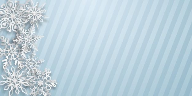 Christmas background with several paper snowflakes with soft shadows on light blue striped background