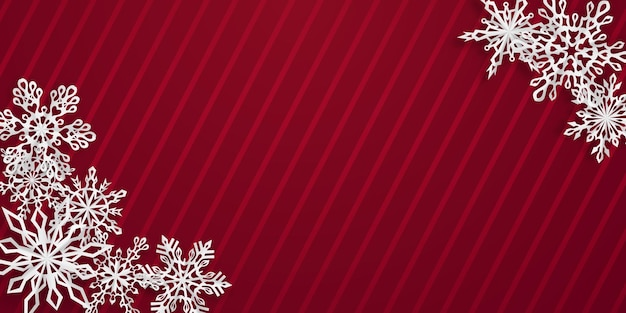 Christmas background with several paper snowflakes with soft shadows on red striped background