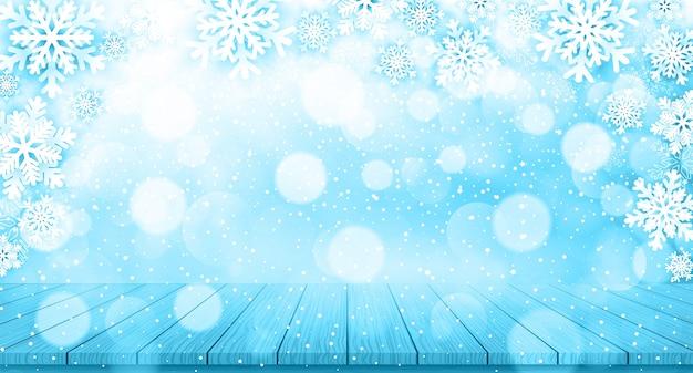 雪片と木製のテーブルとクリスマスの背景
