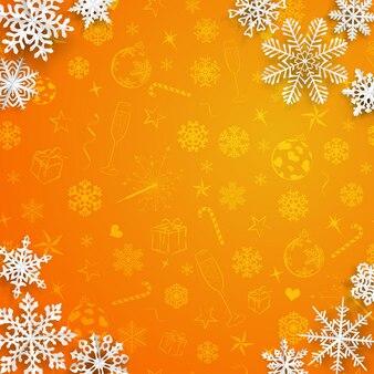 크리스마스 기호의 주황색 배경에 종이에서 잘라낸 눈송이가 있는 크리스마스 배경
