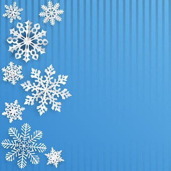 Christmas background with snowflakes cut out of paper on light blue striped background