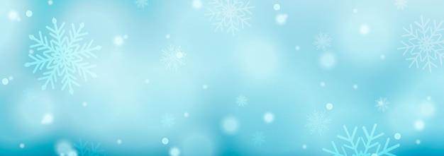 雪片、スターバースト、輝きと光のクリスマスの背景