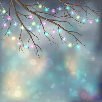 木の枝と輝く装飾的な花輪とクリスマスの背景