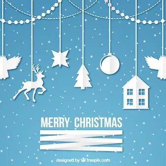 Рождественский фон с типичными рождественскими украшениями, сделанными из бумаги