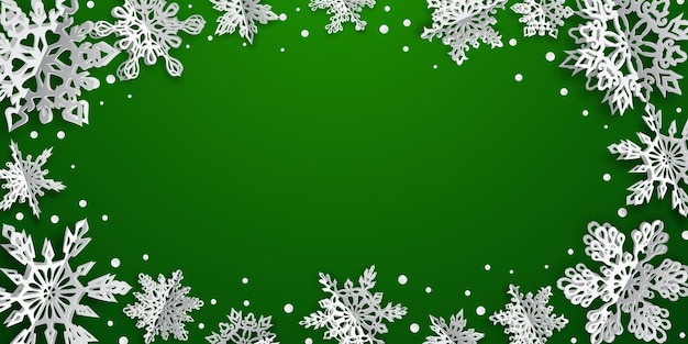 Christmas background with volume paper snowflakes with soft shadows on green background