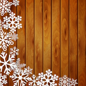 Christmas background with white snowflakes on brown wooden planks