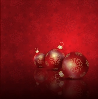 Christmas balls on the floor red background
