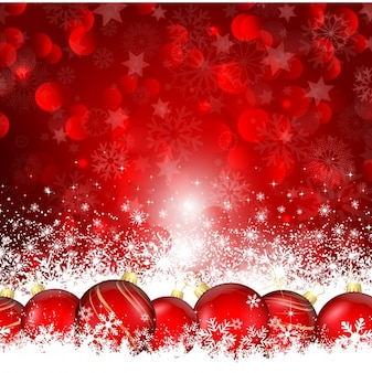 Christmas balls on the snow red background