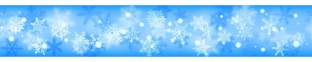 Christmas banner of complex blurred and clear snowflakes in white colors on light blue background. with horizontal repetition