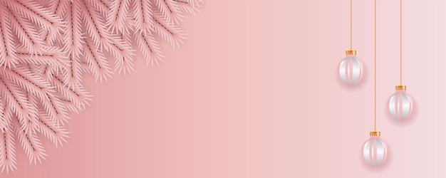ピンク色の松の枝とピンクのボールのコンセプトでクリスマスバナーの装飾
