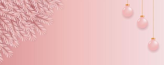 ピンク色の松の枝とピンクのボールでクリスマスバナーの装飾