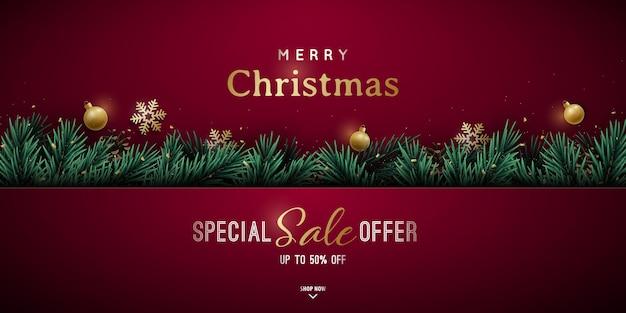 緑のリアルな松の枝とクリスマスバナーのデザイン