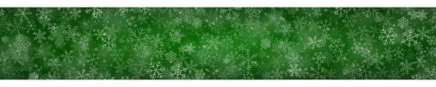 緑の背景にさまざまな形、サイズ、透明度の雪のクリスマスバナー