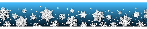 Christmas banner of paper snowflakes with soft shadows, white on light blue background. with seamless horizontal repetition