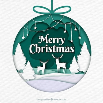 Рождественский bauble украшен сценой в стиле бумаги