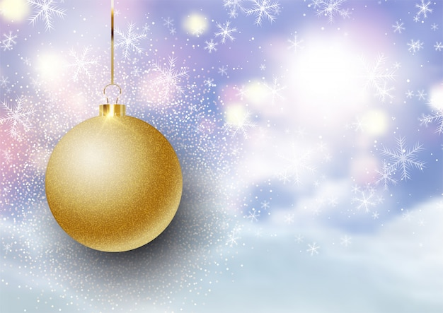 Christmas bauble on defocussed snowy landscape background