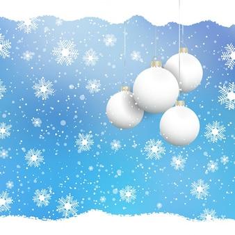 Palline di natale su uno sfondo di fiocco di neve