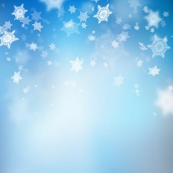 크리스마스 아름 다운 블루 소프트 눈송이 배경 흐림. 또한 포함