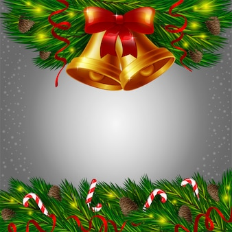 Christmas bells and candy canes on grey background