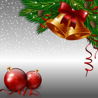 Christmas bells and red baubles on grey background