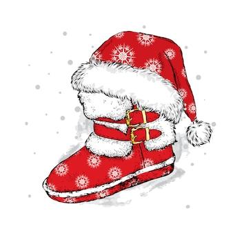 クリスマスブーツとキャップ。クリスマスと新年。