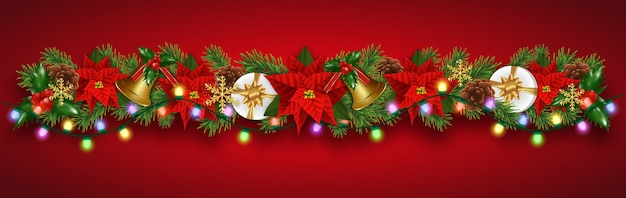 Christmas border decorations garland with fir branches, christmas flowers poinsettia, golden bells, holly berries and gifts boxes.