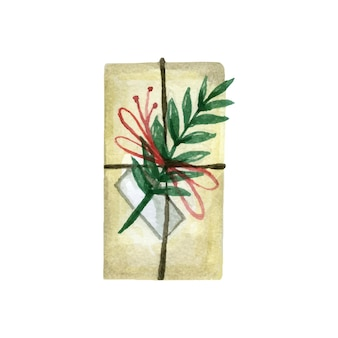 紙で包まれ、枝やリボンで飾られたクリスマスボックス