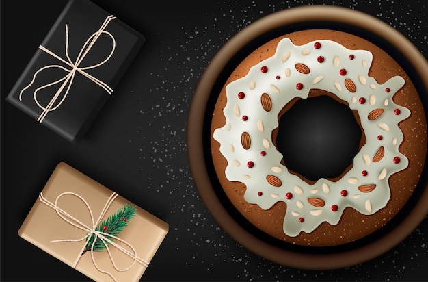 Christmas cake with fruits and nuts on wooden table, top view.