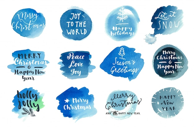 クリスマスの書道の挨拶の上に青い水彩の斑点