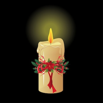 Christmas candle on black isolated background.