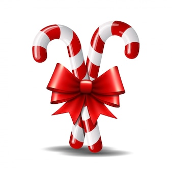 Christmas candy cane with red bow isolated on white