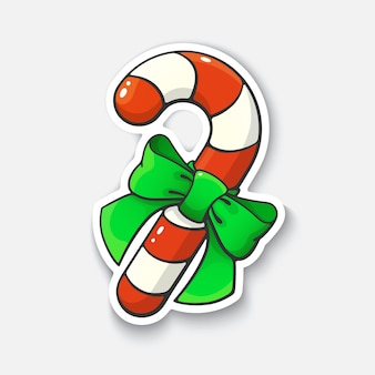 Christmas candy cane with ribbon cartoon sticker in comic style with contour vector illustration