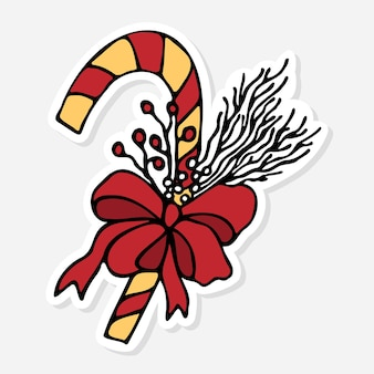 Christmas caramel cane with red bow and holly berries sticker doodlenew year doodle vector