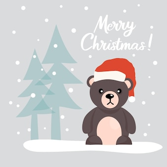 雪に覆われた森のクリスマスツリーの中でサンタクロースの帽子をかぶったかわいいテディベアのクリスマスカード