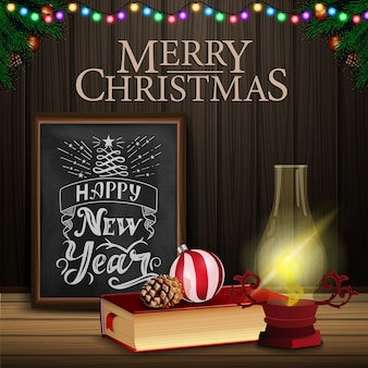 Christmas card with chalkboard, christmas book and old lantern
