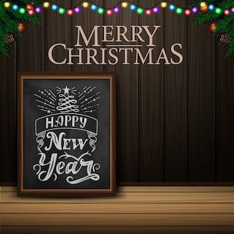 Christmas card with chalkboard on wood background