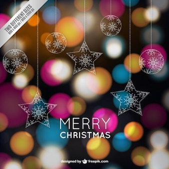 Christmas card with colorful sparkles Free Vector