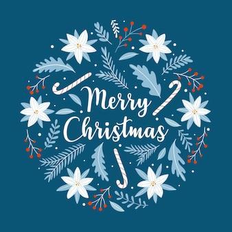 Рождественская открытка с цветами, листьями, ветвями и леденцами на синем фоне. орнамент круга в скандинавском стиле.