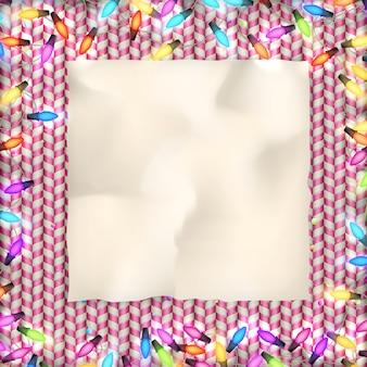 光の花輪付きのクリスマスカード