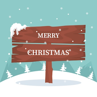 Christmas card with wooden sign in the snow