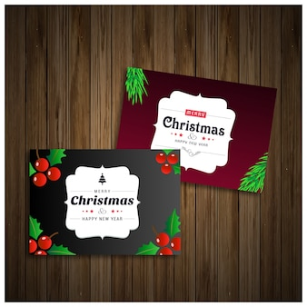 Christmas cards in purple and black color on wooden background