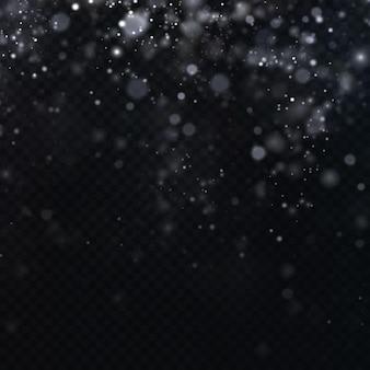 クリスマスのお祝いの紙吹雪の星が降っています