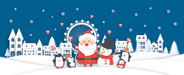 Christmas celebrations with santa in the snow village for christmas card