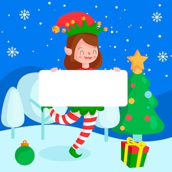 Рождественский персонаж эльф держит пустой баннер