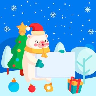 Рождественский персонаж белый медведь держит пустой баннер