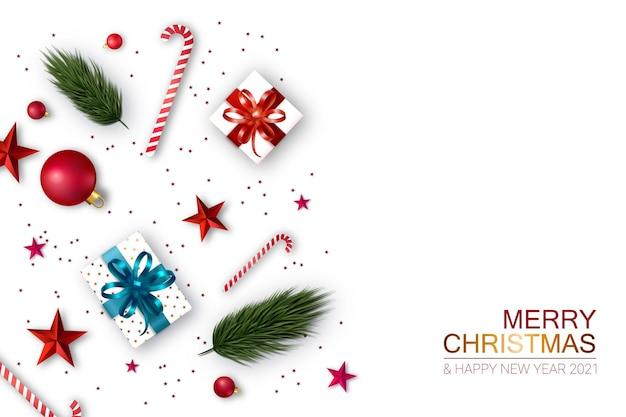クリスマスの構成、ギフト、木の枝、装飾、白い背景。クリスマスと新年のコンセプト