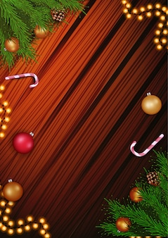 Christmas decoration, branches and candy cane on the wooden background