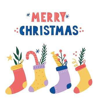キャンディーと甘いクリスマスデコレーションソックス。手描きスタイルのイラスト。冬の休日、クリスマス、新年のコンセプト。