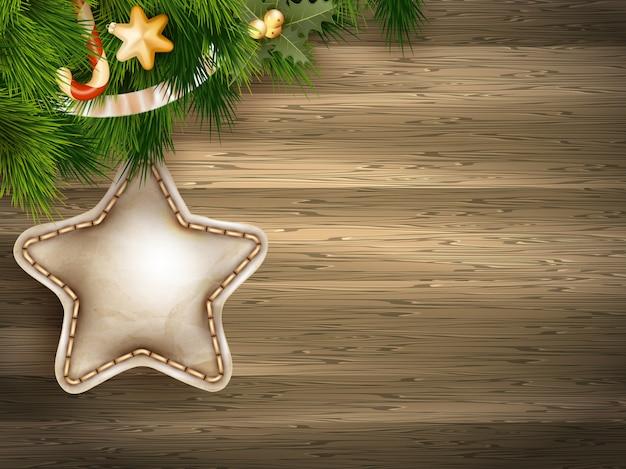 白い木の板にモミの枝でクリスマスの装飾。