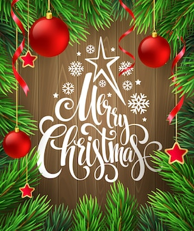 Christmas decoration on wood with lettering, greeting card